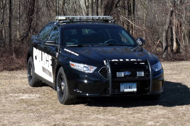 Wilton Police issued an infraction to a Trumbull driver after she veered over the center line and hit another car, causing both to flip.