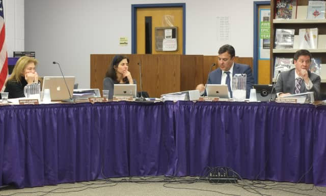 Katohan-Lewisboro School Superintendent Paul Kreutzer (right) talks redistricting with the school board.