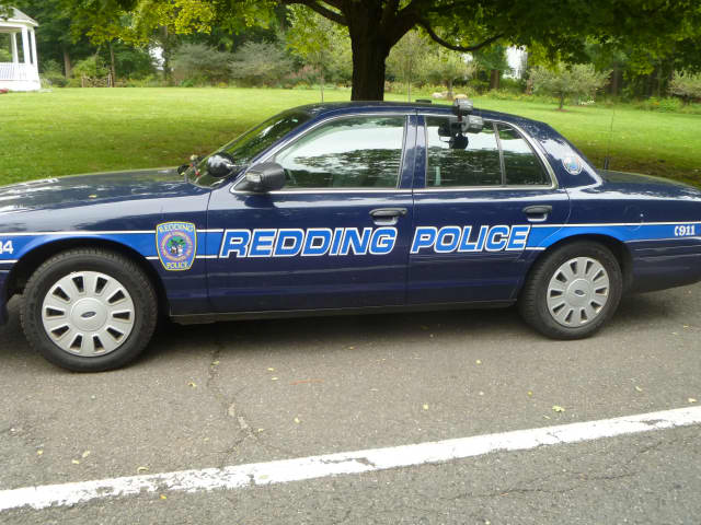 Redding police issued a distracted driving warning to a Ridgefield man who rolled his car on Simpaug Turnpike last week.