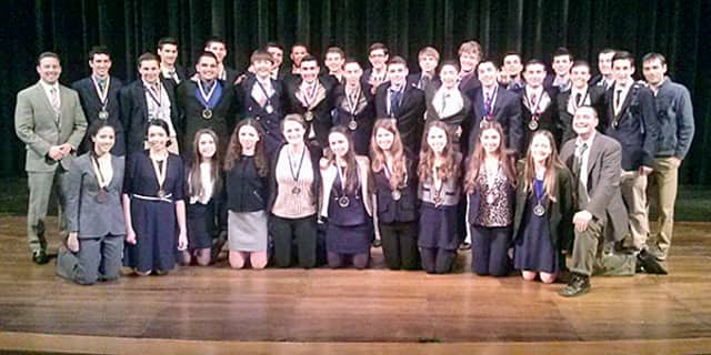 Harrison High School Business Education students excelled at the DECA Regional Championships.