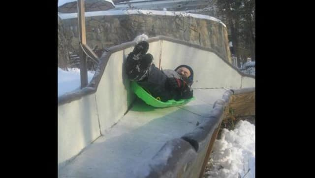 Tucker West glides on a luge run at his Ridgefield home as a youngster. The 18-year-old will represent the United States in the Winter Olympics next month in Sochi.