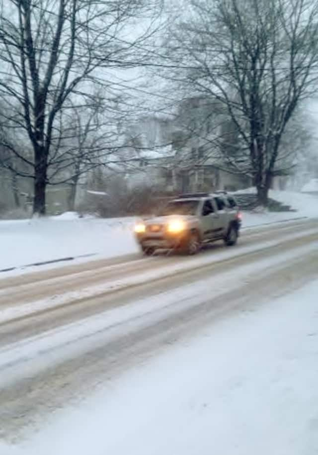 Travel is treacherous Tuesday after the timing of a snowstorm caused whiteout conditions on roads across Fairfield County.