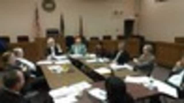 The Cortlandt Town Board, pictured here in 2013, approved a salary resolution that will pay 12 employees a six-figure salary.