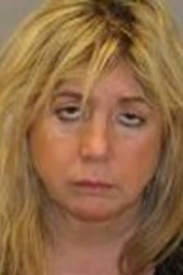 Lisa Rossi of Greenburgh was charged after striking a New York State Police vehicle Saturday on the Sprain Brook Parkway.
