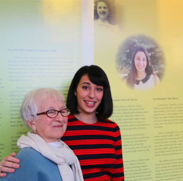 "Manhattanville student Mia Alicata shows her grandmother Assunta Amicone Alicata her panel on the ""Living the Dream"" display at Manhattanville College."