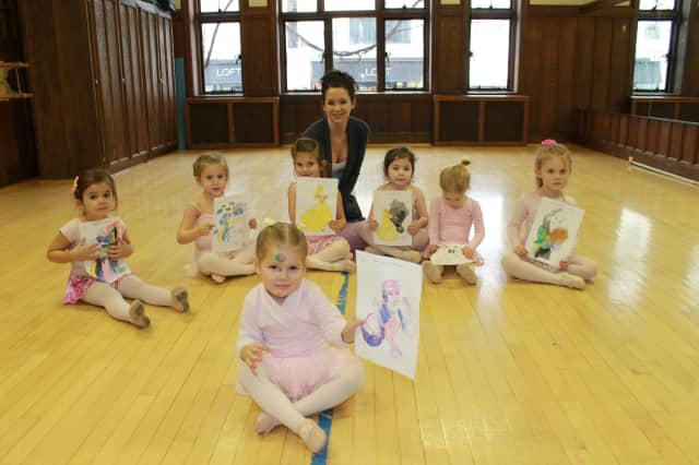 Dance Center Director Lillian Cenatiempo with her dancers at last winter's Princess Dance Camp at the Y.