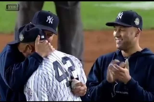 New York Yankee Derek Jeter watches as teammate Mariano Rivera retires last year.
