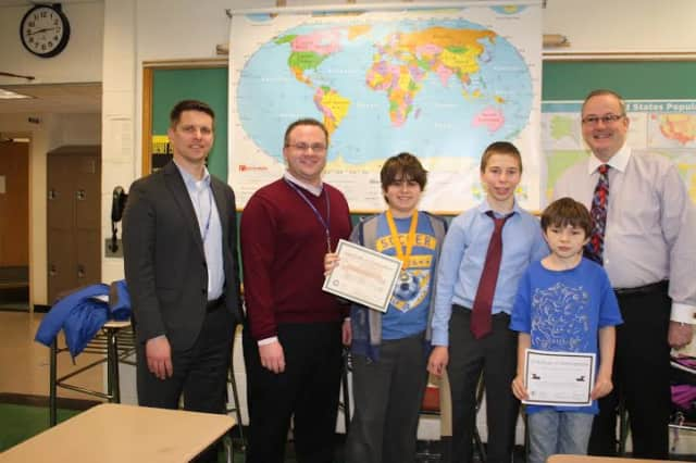 From left, Middle School Assistant Principal Josh Elder, Middle School Principal Scott Wynne, Matthew DeMarco, Adam Ginsburg, Elias Dube and Superintendent of Schools Walter Moran.