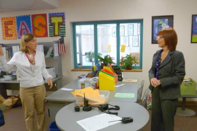 East School Principal Alexandra Potts, left, talks with New Canaan Schools Superintendent Mary Kolek. Potts is set to retire on July 1.