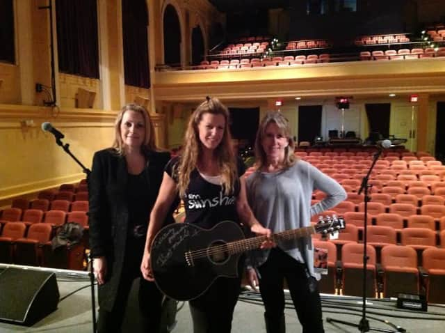 Ridgefield Playhouse's Suzanne Brennan, chief development officer; Allison Stockel, executive director with the Brett Michaels'-signed guitar and Julie Paltauf, chief financial officer.