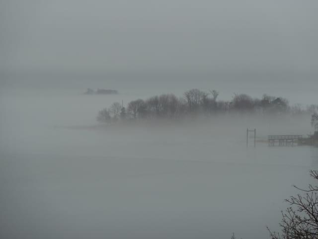 Fog rolls across Long Island Sound along the Connecticut shoreline.