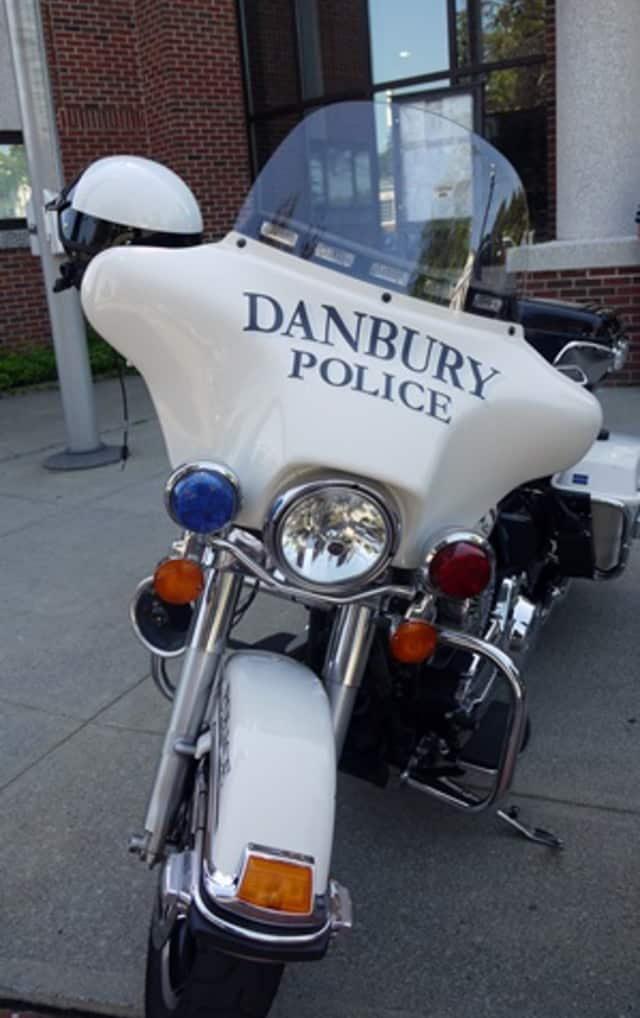Danbury Police arrested a local man after he was allegedly threatening people with a stolen handgun recently.