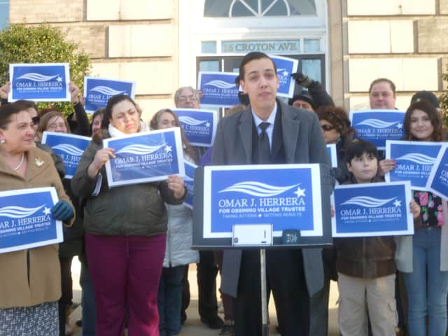Omar Herrera announces his candidacy for Ossining village trustee outside Ossining Village Hall.