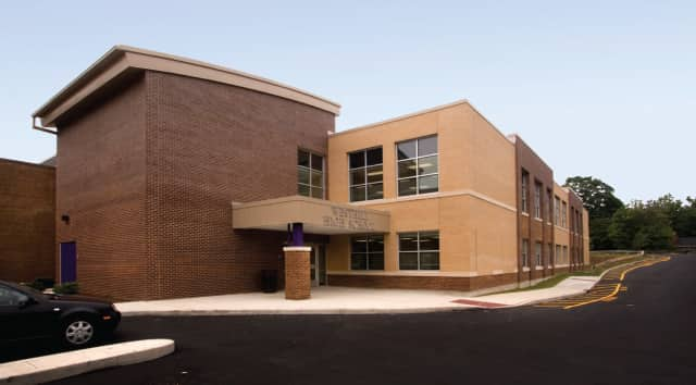 A substitute teacher was arrested at Westhill High School by Stamford police after performing an inappropriate sexual act in the school building.