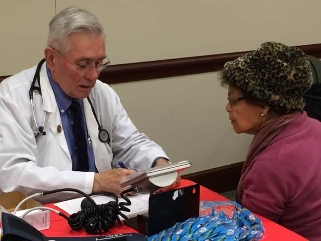 John Gibb, RN, records a blood pressure reading in Darien. The Wilton Y begins enrollment Tuesday for the YMCA's Blood Pressure Self-Monitoring Program.