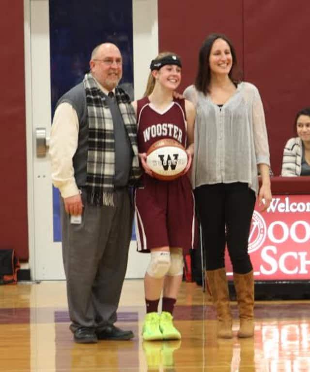 Wooster School senior Kate MacNutt was honored for scoring her 1,000 career point recently.
