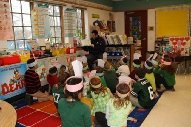 """Members of the the Pace University Athletics Department took part in """"Read Across Amreica"""" at Bedford Road School in Pleasantville."""