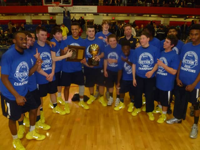 The Walter Panas boys basketball team, seen here with their Section 1 championship trophy, fell to Red Hook in the Class A state regional final in Beacon.