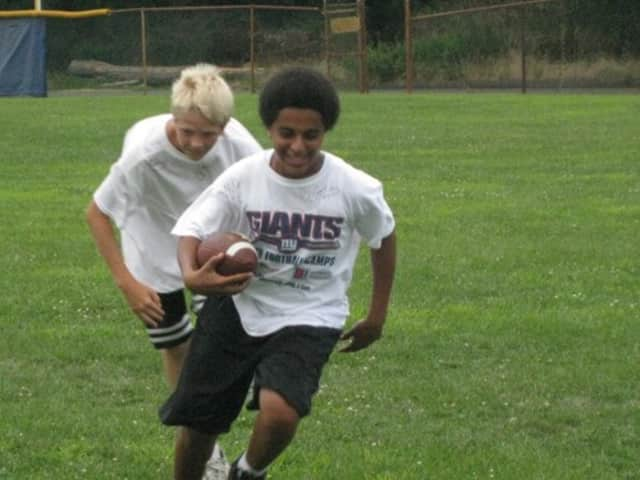 Football camps run by the New York Giants are coming to New Canaan, Stamford and Greenwich this summer.