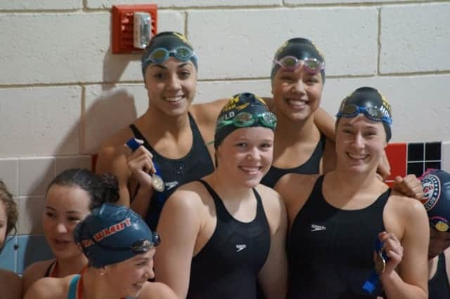 Norwalk's  Ky-lee Perry joins Wilton Wahoo teammates Samantha Cheruk, Emma Holmquist and Emma Kauffeld.  The unit finished third in the 200 free relay.