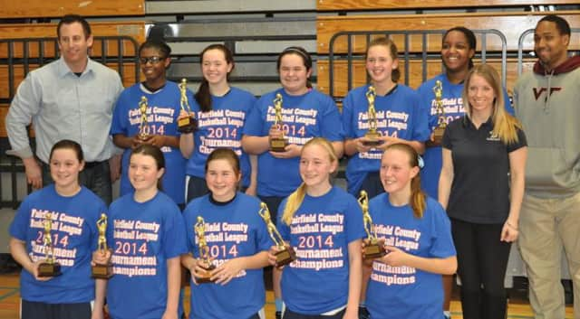 The Wilton 7th grade girls travel basketball team celebrates its Fairfield County Basketball League championship.