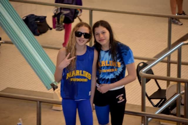 Members of the Marlins swim team pose after their swim meet.