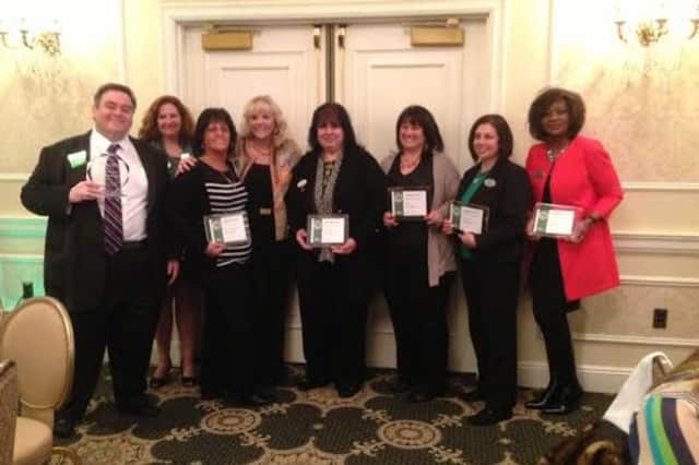 Better Homes & Gardens Rand Realty Realtors were honored at a recent ceremony at the Pearl River Hilton.
