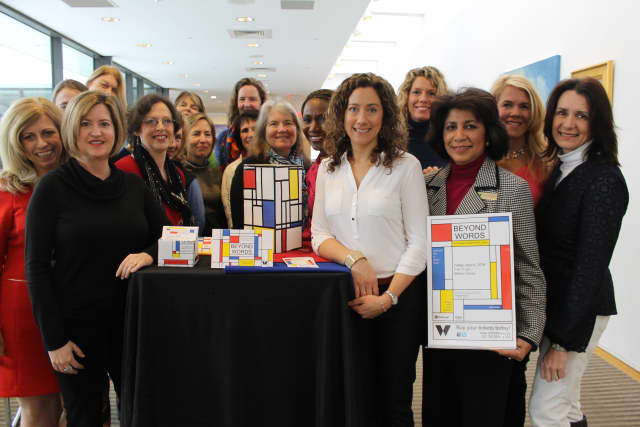 The planning committee for Wilton Library's Beyond Word benefit pictured above unveils the Mondrian theme of the event.