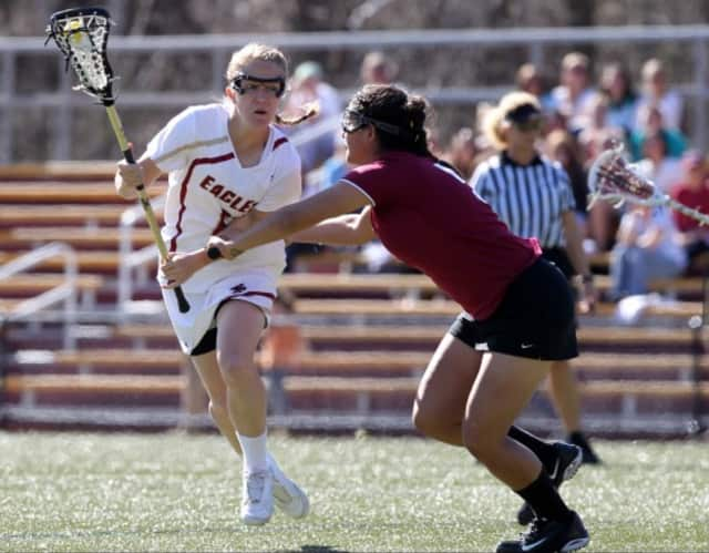 Sarah Mannelly of New Canaan was honored at Boston College after scoring four goals in a loss to No. 1 North Carolina last week.