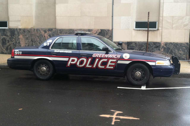 Greenwich Police charged a man with assault after he allegedly punched a bar bouncer in the eye.