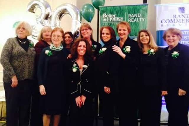 Jo Falcone, manger of the Better Homes and Gardens Rand Realty, Thornwood Office, celebrates with agents at the recent awards breakfast.