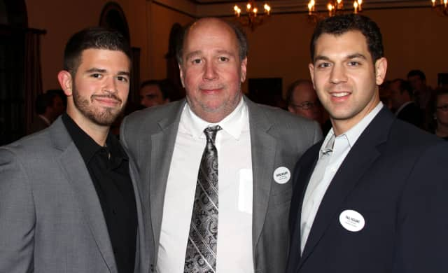 George Williams, center, president and CEO of A.G. Williams Painting Co. in Pelham, was honored as one of the Best Bosses in Westchester by 914Inc.