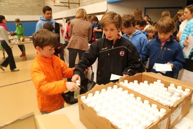 New Canaan Country School students worked together in buddies to assemble emergency kits for AmeriCares as part of an ongoing service learning partnership.