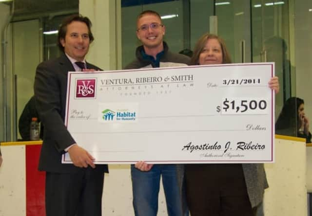 Danbury law firm Ventura, Ribeiro & Smith recently teamed up with the Danbury Whalers to raise money. Derek Roy, center, the organization's Strategic Planning  Chairman, and Executive Director Fran Normann, right, accepted the check.