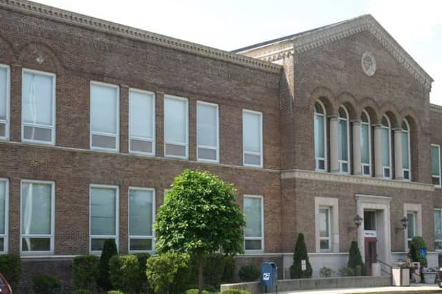 A threatening letter was found on the ground at Darien Town Hall, prompting bomb-sniffing dogs to be brought in.
