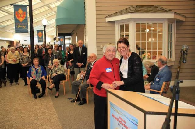 Long-time Waveny volunteer Fiz Tomaselli is presented with an award for her 3,700 volunteer hours of service.