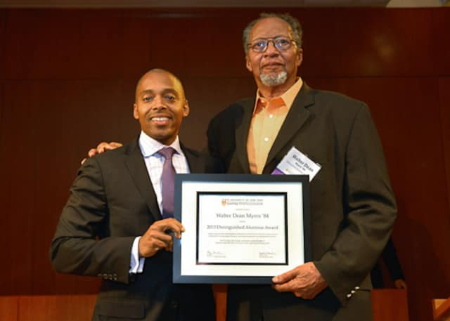 Khalil Gibran Muhammad, left, director of The Schomburg Center for Research in Black Culture, a research unit of The New York Public Library, presents Walter Dean Myers with the 2013 Distinguished Alumni Award.