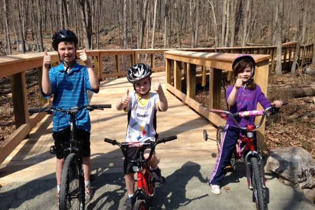 Kids give a thumbs up for the new Wilton Demo Trail that will open to the public on April 26.