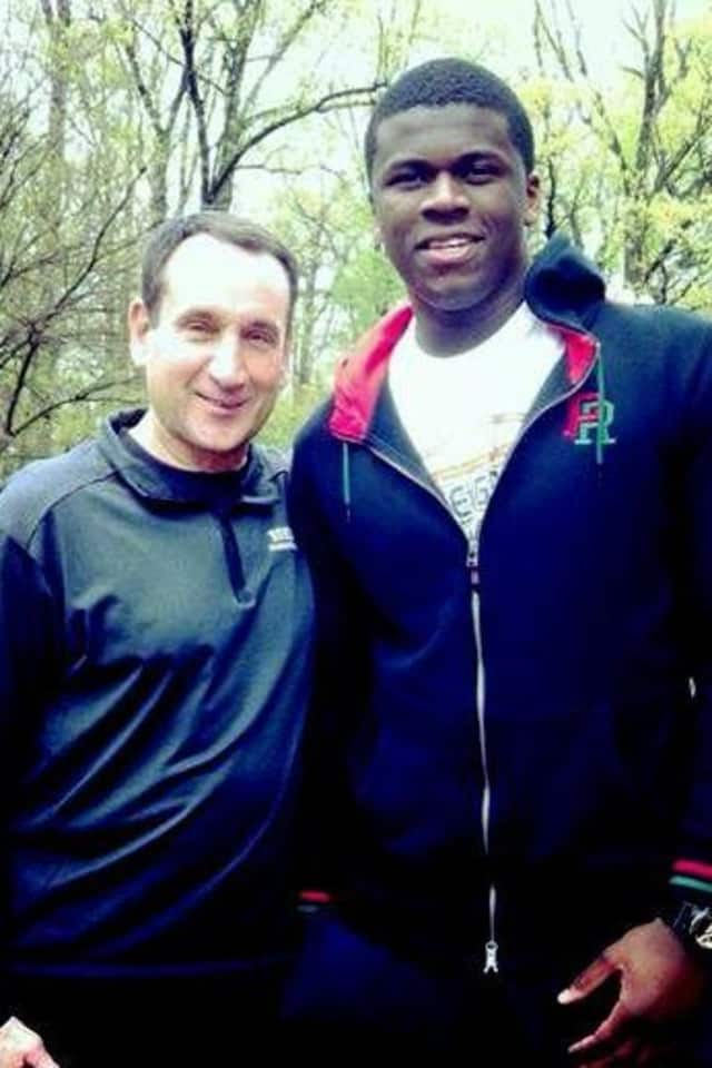 Former Greens Farms Academy basketball star Sean Obi, right, met Duke basketball coach Mike Krzyzewski this week. Obi will transfer to Duke from Rice.