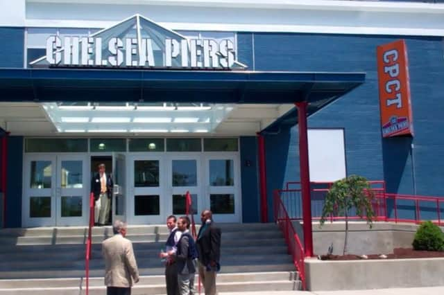 A New Canaan boy who nearly drowned in a pool Thursday at Chelsea Piers in Stamford remains in the hospital in a coma on Friday.