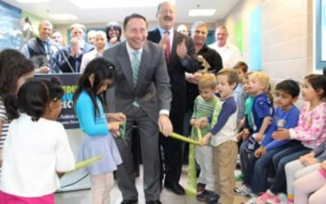 County Executive Rob Astorino and kindergartners from Edgemont's Seely Place School cut the ribbon at the opening of the Recycled Material Art Gallery.