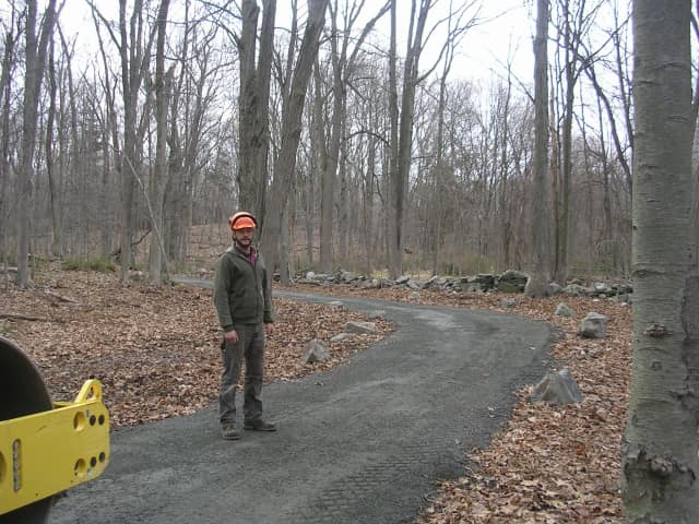 A worker stands on the Norwalk River Valley Trail in Wilton. A piece of the trail is finished and a ribbon cutting will be held on Saturday.