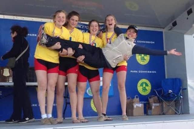 Maggie Owen, Tate Aronstein, Siobhan Naughton and Kim Dyrvik with coach Anna Cherednikova, celebrate a gold medal in the Novice 4x.