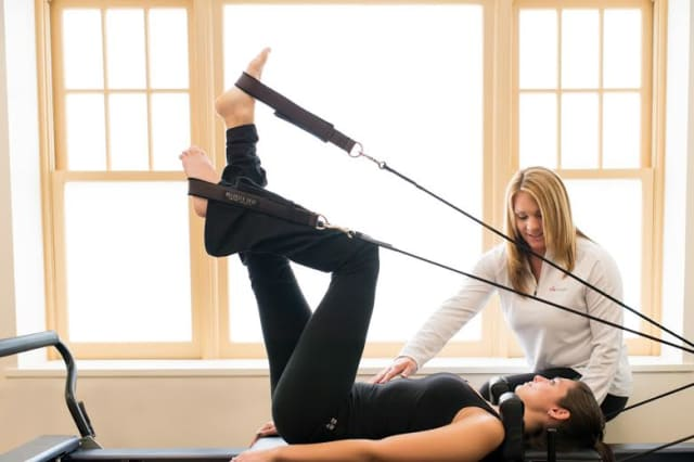 Ella Health has opened a new center located in the heart of Westport. Physical Therapist Sarah Hnath demonstrates Pilates-based techniques with Lindsay Squire.