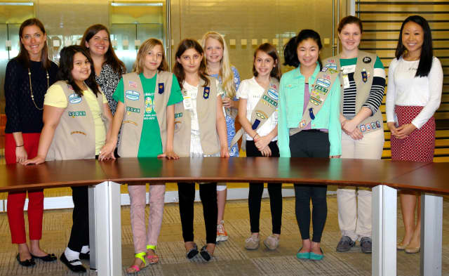 A group of Girl Scouts pose at GE's Corporate location in Stamford.