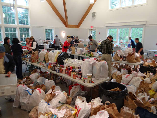 Volunteers sort food donations at Person-2-Person in Darien.