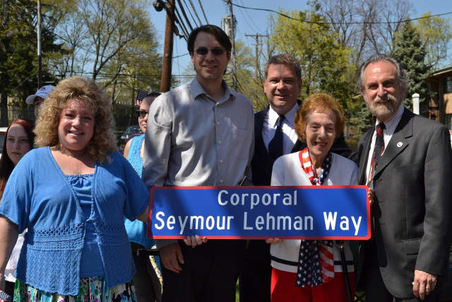 Rosalind Lehman, the widow of Seymour Lehman, joins family members, Yonkers Mayor Mike Spano and City Council Minority Leader Michael Sabatino to officially dedicate a portion of Gateway Road in memory of Lehman.