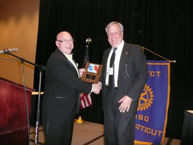 Wilton Rotarian Patrick Russo (at right) is recognized for his community service.