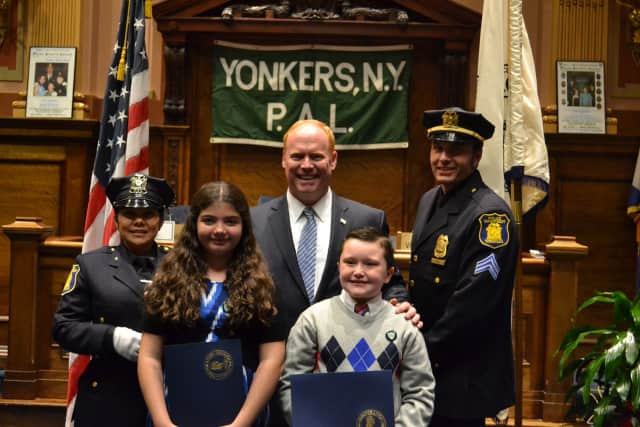 Pictured, from left, are Yonkers Police Officer of the Year Officer Jacquelyn Estevez, Christina Ljuljic, Council President Liam J. McLaughlin, Colin Nowak and Officer of the Year Sergeant Patrick York.