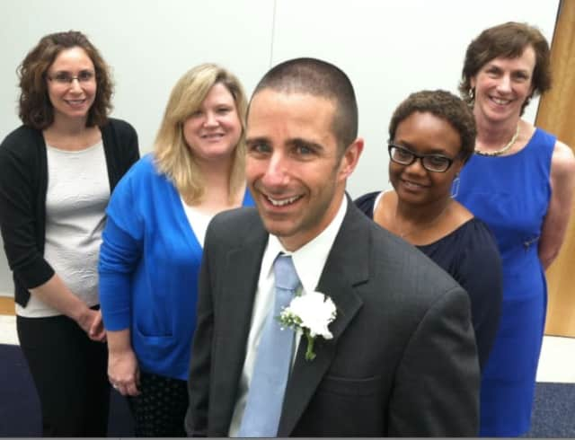 Springdale Elementary School Grade 4 teacher Jimmy Sapia, center, was named Stamford's Teacher of the Year. He's pictured with fellow teachers, from left: Michelle Davis, Kim Cassette, Tracy Winn, and principal Anne Downey at the Thursday ceremony.